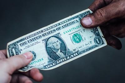 dollar bill giving